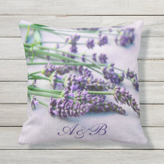 Monogrammed lavender on gray french country style outdoor pillow