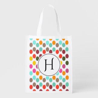 Monogrammed polka dot pattern in red blue white reusable grocery bag