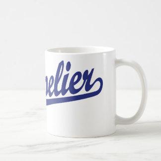 Montpelier script logo in blue coffee mug