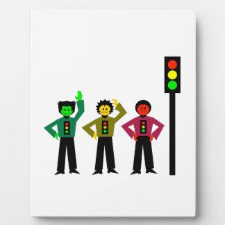 Moody Stoplight Trio Next to Stoplight Plaque