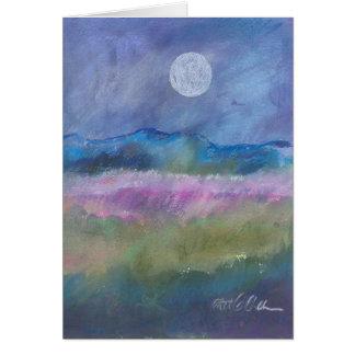 Moon over desert field. card