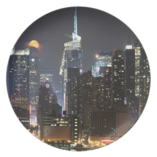Moon rises over midtown New York. Party Plates