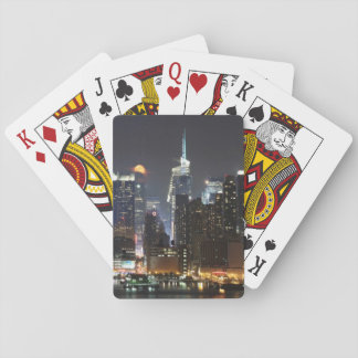 Moon rises over midtown New York. Playing Cards
