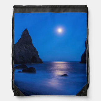 Moonrise reflection on ocean and sea stacks drawstring backpack
