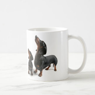 Mosquito with two dogs, dachshund coffee mug