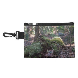 Moss covered fallen tree in a forest accessory bag