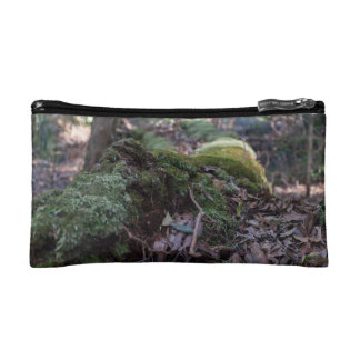 Moss covered fallen tree in a forest cosmetic bag