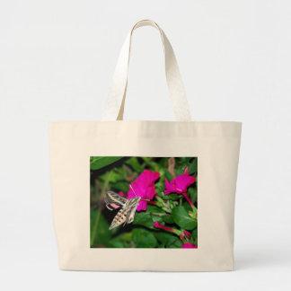 Moth Feeding on Pink Flower Canvas Bag