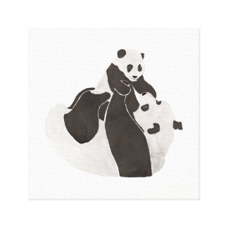 Mother and baby panda playing canvas print