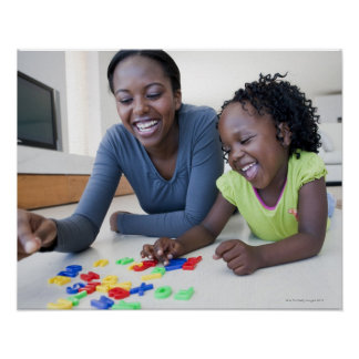 Mother and daughter playing with letters poster