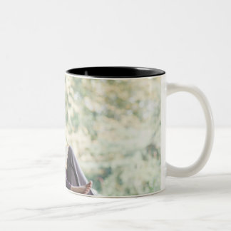 Mother and daughter reading storybook Two-Tone coffee mug