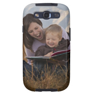 Mother and son reading outdoors galaxy SIII cover