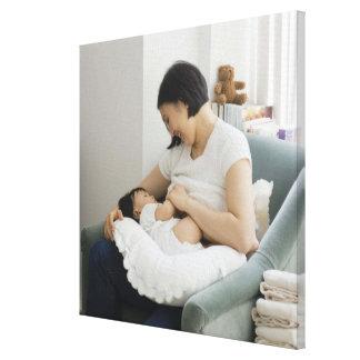 Mother breast feeding baby girl canvas print