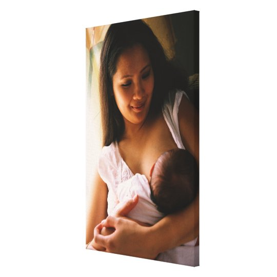 Mother breast feeding newborn canvas print