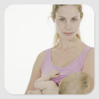Mother breastfeeding her baby. 2 square sticker