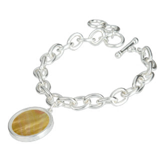 Mother of pearl tones gold charm bracelets