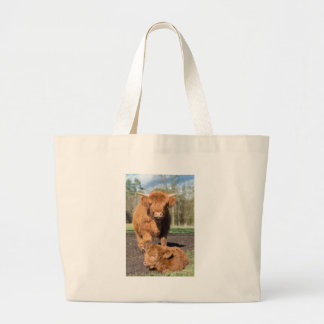 Mother scottish highlander cow near newborn calf large tote bag