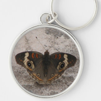 Moths wing pattern of a snakes head Silver-Colored round keychain
