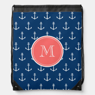 Motif blanc d'ancres de bleu marine, monogramme de sacs avec cordons
