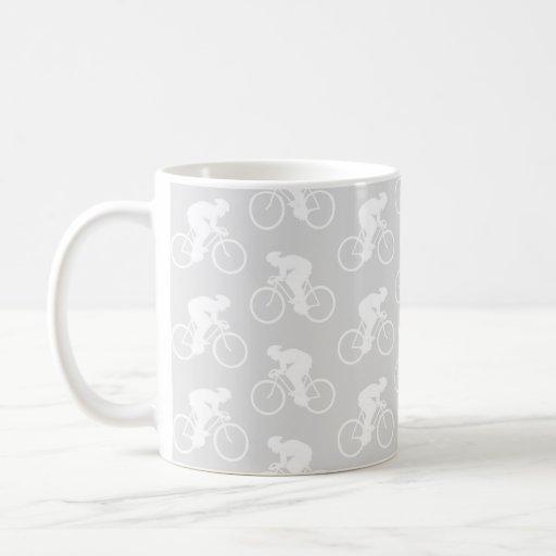Motif de cycliste et de bicyclette dans le gris tasses