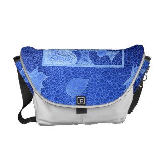 Motifs feuilles et poissons en bleu sacoche