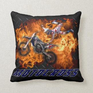 Motocross racing through fire. throw pillow