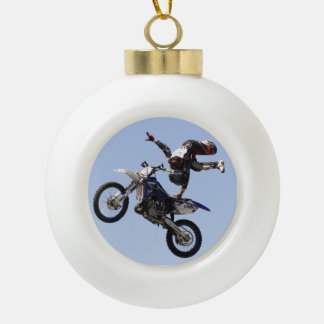 Motocross rider flying high with one hand grab ceramic ball christmas ornament