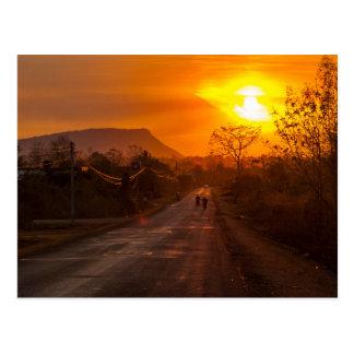 Motorbiking in sunset postcard
