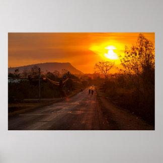 Motorbiking in sunset poster