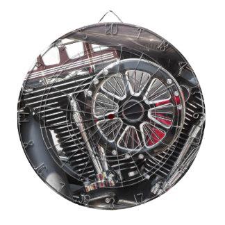 Motorcycle chromed engine detail background dart board
