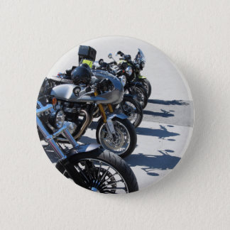 Motorcycles parked in row on asphalt 2 inch round button
