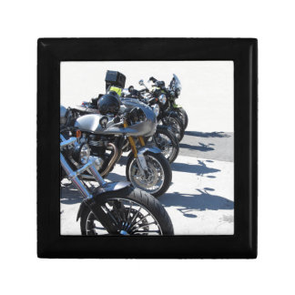 Motorcycles parked in row on asphalt gift box