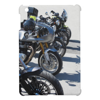 Motorcycles parked in row on asphalt iPad mini cover