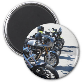 Motorcycles parked in row on asphalt magnet
