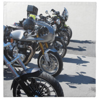 Motorcycles parked in row on asphalt printed napkins
