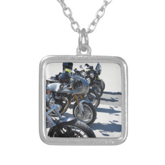 Motorcycles parked in row on asphalt silver plated necklace