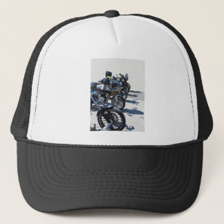 Motorcycles parked in row on asphalt trucker hat