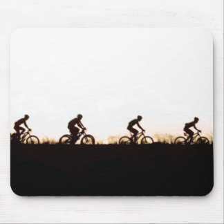 Mountain Bike Riders Make Their Way Over The Dam Mouse Pad