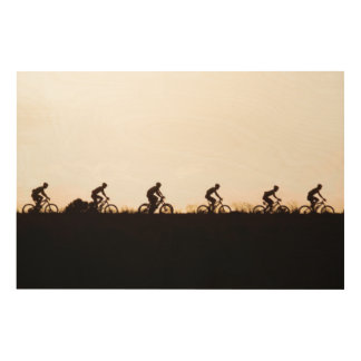 Mountain Bike Riders Make Their Way Over The Dam Wood Canvas
