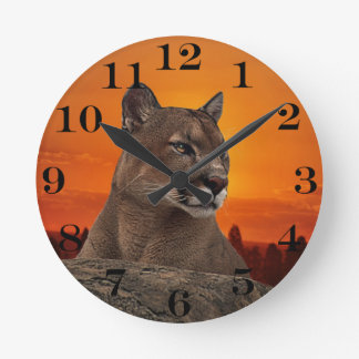 Mountain lion at sunset round clock