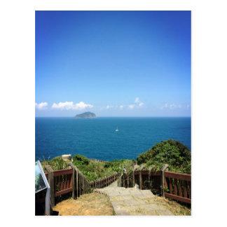 Mountain, ocean, sailboat, isle postcard