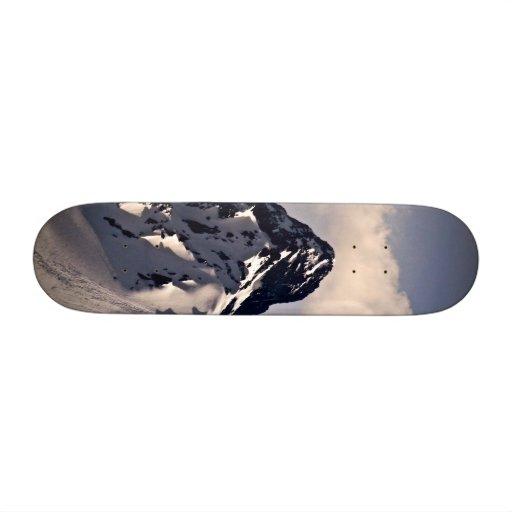 MOUNTAIN PEAK WITH WHITE CLOUD AND SNOW SKATE DECKS