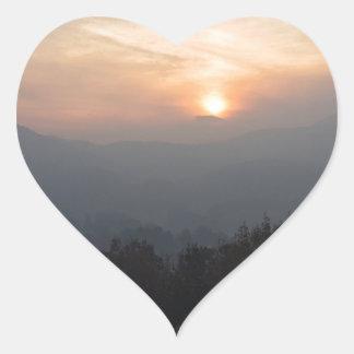 mountain sunset in a haze heart sticker