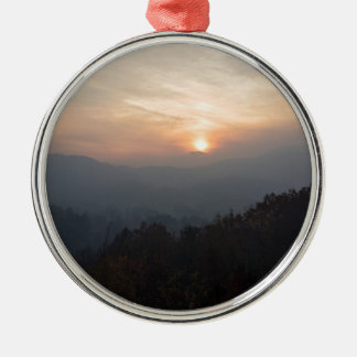 mountain sunset in a haze metal ornament
