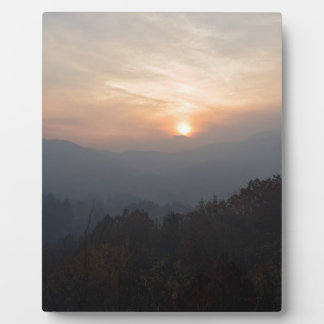 mountain sunset in a haze plaque