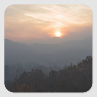 mountain sunset in a haze square sticker