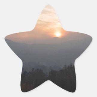 mountain sunset in a haze star sticker