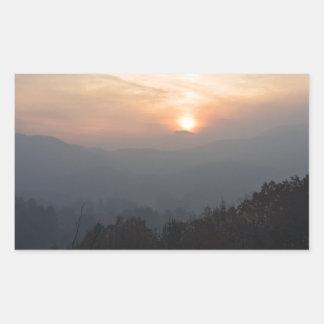 mountain sunset in a haze sticker