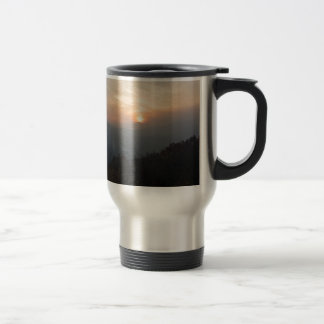 mountain sunset in a haze travel mug