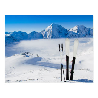 Mountains and ski equipment postcard